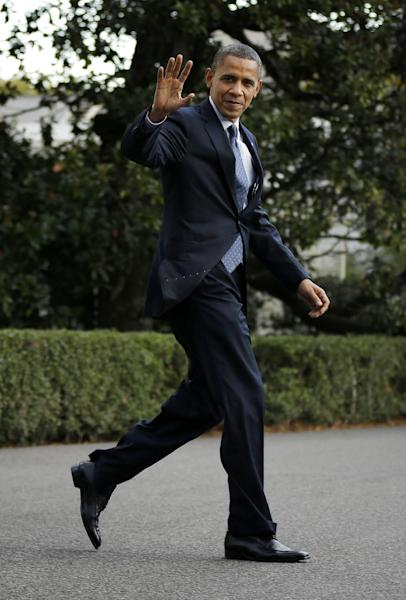 """FILE - This Oct. 19, 2012 file photo shows President Barack Obama waving to members of the media as he walks across the South Lawn of the White House in Washington. Nickelodeon's Linda Ellerbee said Monday, Oct. 22, that the president captured 65 percent of the vote to beat Republican Mitt Romney in the network's """"Kids Pick the President"""" vote. More than 520,000 people cast online ballots through the children's network's website over one week earlier this month. (AP Photo/Pablo Martinez Monsivais, file)"""