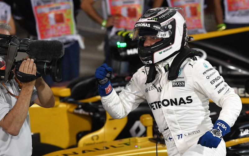 Valtteri Bottas celebrates his first pole position in Formula One - AFP
