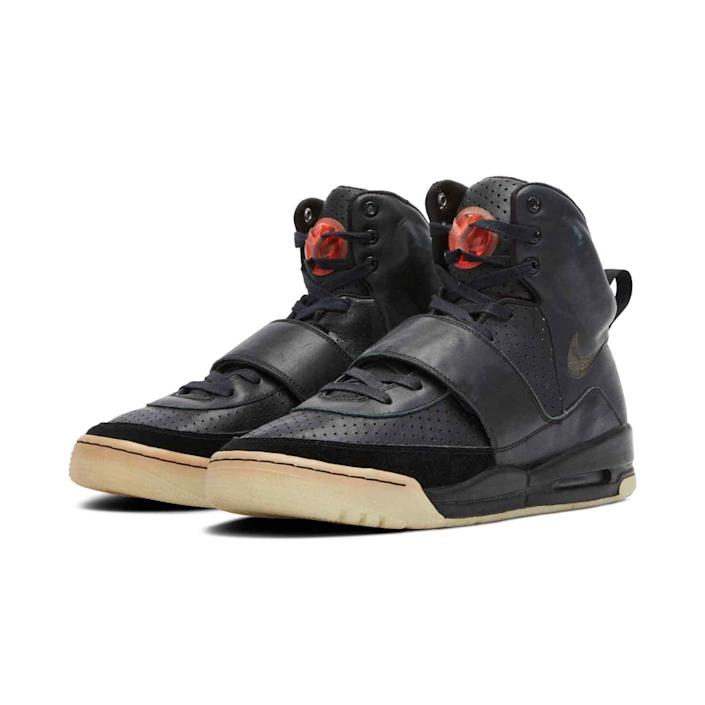 Black Air Yeezy 1 sneakers.