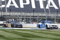 Chase Briscoe (14) and Cole Custer (41) drives through a turn during the NASCAR Series auto race at Indianapolis Motor Speedway, Sunday, Aug. 15, 2021, in Indianapolis. (AP Photo/Rob Baker)