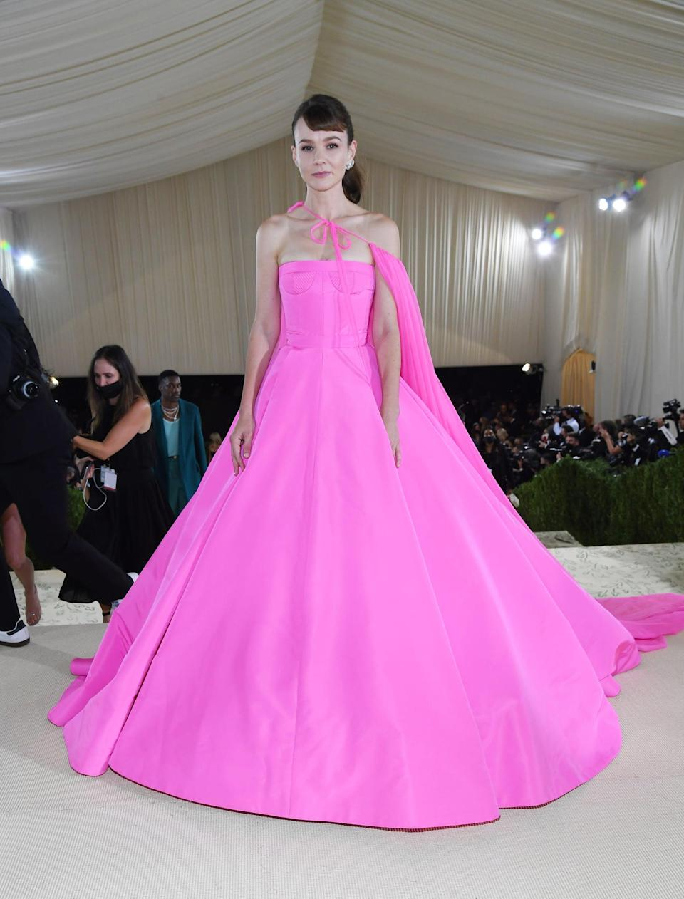 <p>Wearing a Valentino dress with Cartier jewels. </p>