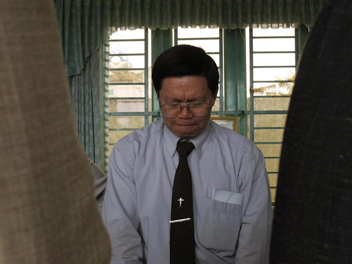 In this photo taken Wednesday, Sept. 25, 2013, a Vietnamese protestant preacher prays for the success of a delegation of American Christians seeking to promote religious harmony in the Vietnamese central highland town of Pleiku. Vietnam allows state-sanctioned faiths to grow, but continues to keep a close watch on all religious institutions. In the central highlands, the state believes that small unlicensed churches are often used as a cover for separatist activities. (AP Photo/Chris Brummitt)