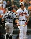 Baltimore Orioles' Chris Davis, right, reacts after striking out swinging to end the third inning of a baseball game against the Chicago White Sox, Sunday, Sept. 8, 2013, in Baltimore. (AP Photo/Patrick Semansky)