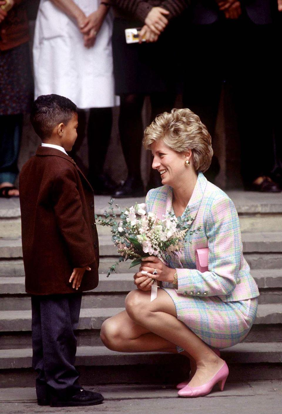 "<p>When Diana spoke with children, she always crouched to see them at eye-level. ""Diana was the first member of the royal family to do this,"" said Ingrid Seward, editor of <em>Majesty</em> magazine. ""The royal family used to say that everyone had to be deferential to them. But Diana said, 'If someone might be nervous of you or you're speaking to a very young child or a sick person, get yourself on their level.'""</p>"