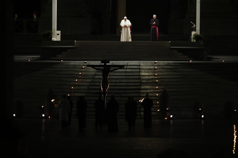 Pope Francis presides over the Via Crucis – or Way of the Cross – ceremony in St. Peter's Square empty of the faithful following Italy's ban on gatherings to contain coronavirus contagion, at the Vatican, Friday, April 10, 2020. (AP Photo/Alessandra Tarantino)