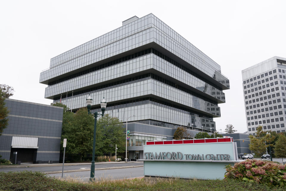 FILE- In this Wednesday, Oct. 21, 2020, file photo Purdue Pharma headquarters stands in Stamford, Conn. Proposed settlements between the federal government and OxyContin maker Purdue Pharma and its owners cleared a major legal hurdle Tuesday, Nov. 17, 2020, when a bankruptcy judge said they could move ahead. (AP Photo/Mark Lennihan, File)