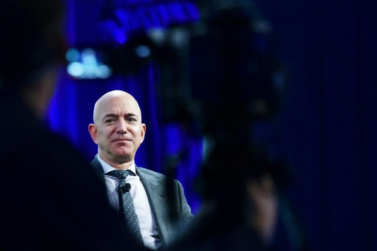 """Billionaire Jeff Bezos is riding high after flying into space in July 2021, but his space flight company Blue Origin is accused of having a """"toxic"""" work culture (AFP/MANDEL NGAN)"""