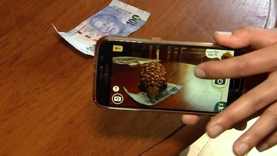"The interactive app called 'Safari Central"" allows users to interact with augmented reality versions (AR) of actual animals while educating them on their conservations issues. Elly Park reports."