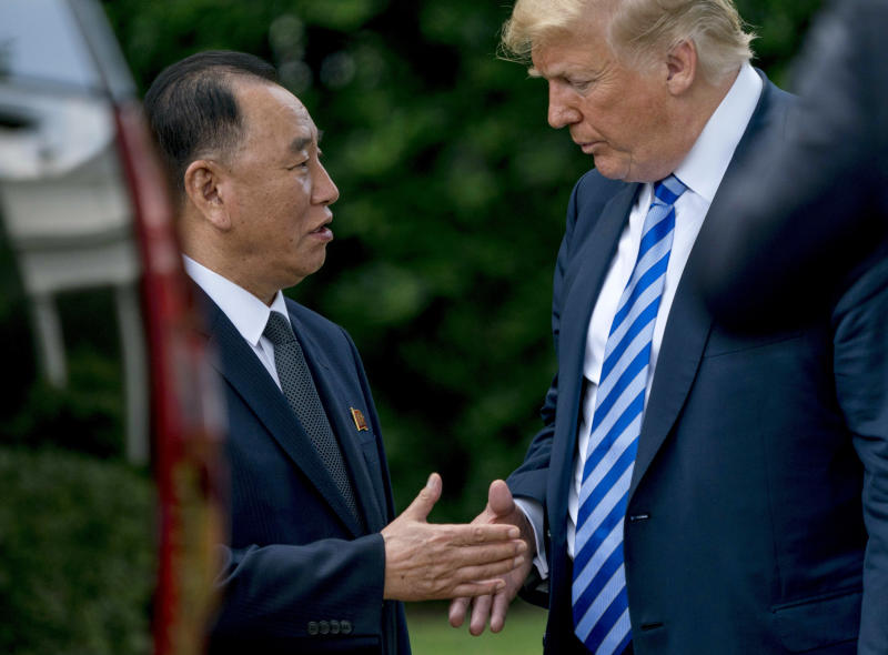 FILE - In this June 1, 2018 file photo, President Donald Trump shakes hands with Kim Yong Chol, former North Korean military intelligence chief and one of leader Kim Jong Un's closest aides, as after their meeting in the Oval Office of the White House in Washington. The head of South Korean parliament's intelligence committee, Lee Hye-hoon, on Wednesday, April 24, 2019 cited South Korea's main spy agency as saying that Kim Yong Chol lost his Workers' Party post in charge of relations with South Korea. (AP Photo/Andrew Harnik, File)