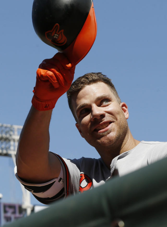 Baltimore Orioles' Chris Davis tips his helmet to cheering fans following his solo home run off Minnesota Twins pitcher Matt Magill in the ninth inning of a baseball game Sunday, July 8, 2018, in Minneapolis. (AP Photo/Jim Mone)
