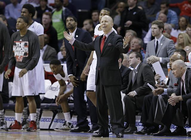 Cincinnati coach Mick Cronin reacts to a call that went against his team during the second half of an NCAA college basketball game against Connecticut in the semifinals of the American Athletic Conference men's tournament Friday, March 14, 2014, in Memphis, Tenn. Connecticut won 58-56. (AP Photo/Mark Humphrey)