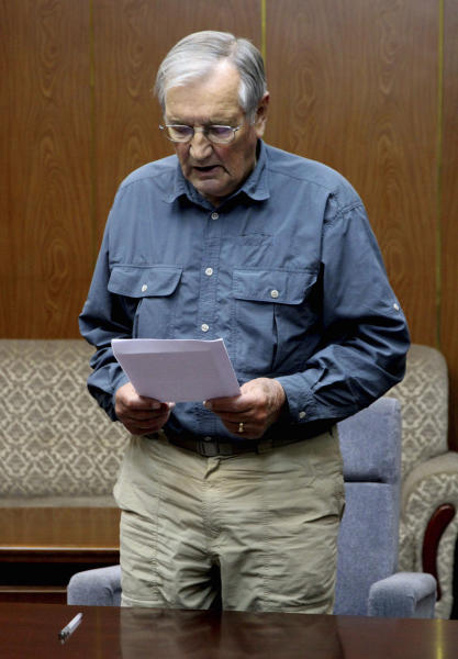 In this Nov. 9, 2013 photo released by the Korean Central News Agency (KCNA) and distributed Nov. 30, 2013 by the Korea News Service, U.S. citizen Merrill Newman, 85, reads a document, which North Korean authorities say was an apology that Newman wrote and read in North Korea. Newman, an avid traveler and retired finance executive, was taken off a plane Oct. 26 by North Korean authorities while preparing to leave the country after a 10-day tour. (AP Photo/KCNA via KNS) JAPAN OUT UNTIL 14 DAYS AFTER THE DAY OF TRANSMISSION