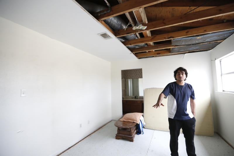 Angel Silva talks about the blast that damaged his newly purchased home on Bridgeland Lane in Houston, Sunday, Jan. 26, 2020, after the Watson Grinding Manufacturing explosion early Friday morning. (Karen Warren/Houston Chronicle via AP)