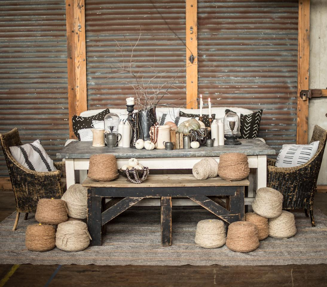 """<p>Jack-o-lanterns, spooky bats, and cobwebs aren't the only festive seasonal symbols. You can opt for a rustic fall theme instead to celebrate. """"Our beloved zinc-topped table is adorned with cozy details, making it the ideal place to gather around and share some All Hallows' Eve stories,"""" Jeni Maus of <a rel=""""nofollow"""" href=""""http://www.foundrentals.com/"""">Found Vintage Rentals</a> says. """"Neutral tones of orange, creams, dark brown, and black are paired with rich texture and patina. Pumpkins, wool yarn, and bare branches add a whimsical touch of fall."""" There are still some mysterious elements like vintage books, pewter-like jugs, and dripping candles that help set the Halloween scene.</p>"""