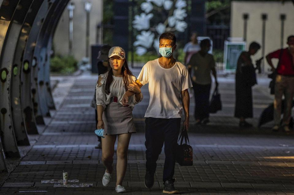 A couple walks through the Shanghai Marriage Market in the People's Park in Shanghai onAugust 9, 2020. Photo: EPA-EFE