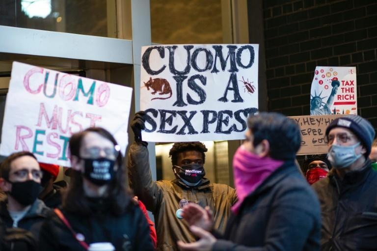 About a dozen protesters gathered in New York to demand the resignation of Governor Andrew Cuomo over claims of sexual harassment