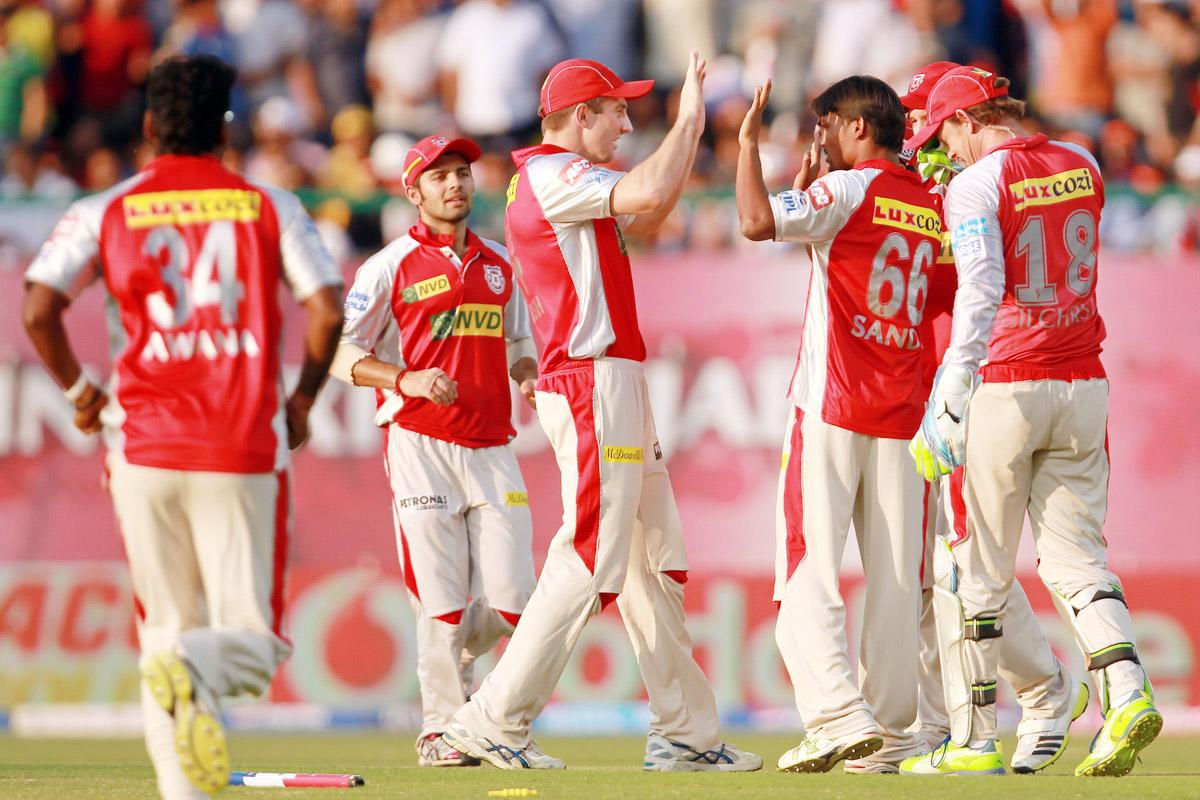 Sandeep Sharma is congratulated by his teammates after taking the wicket of Aditya Tare during match 69 of the Pepsi Indian Premier League between The Kings XI Punjab and the Mumbai Indians held at the HPCA Stadium in Dharamsala, Himachal Pradesh, India on the on the 18th May 2013. (BCCI)