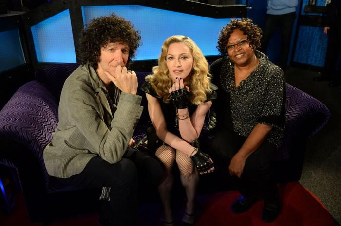 Howard Stern with co-host Robin Quivers on Sirius Radio's Howard 100 with Madonna on a couch after an interview.
