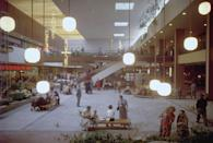 "<p>Your errands became much easier to get through when the first ""modern"" indoor shopping mall <a href=""http://www.metv.com/stories/this-is-what-the-first-shopping-mall-in-the-united-states-looked-like"" rel=""nofollow noopener"" target=""_blank"" data-ylk=""slk:opens in Minnesota"" class=""link rapid-noclick-resp"">opens in Minnesota</a> on October 8. We can't help but love this very-of-the-era design.</p>"