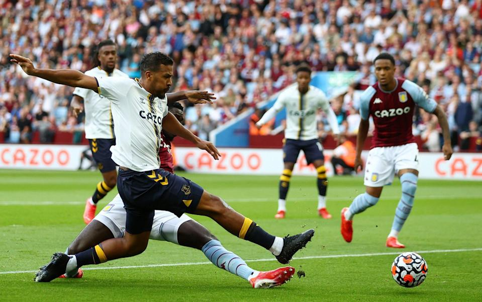 Jose Salomon Rondon of Everton shoots under pressure from Axel Tuanzebe. - Michael Steele/Getty Images