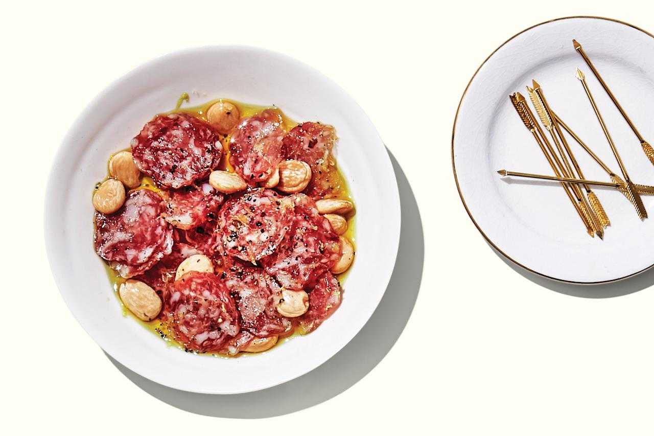 """Bright citrus and fresh-ground pepper put a festive spin on two party staples: cured meat and Marcona almonds. <a href=""""https://www.epicurious.com/recipes/food/views/lemon-pepper-salami-bites?mbid=synd_yahoo_rss"""">See recipe.</a>"""