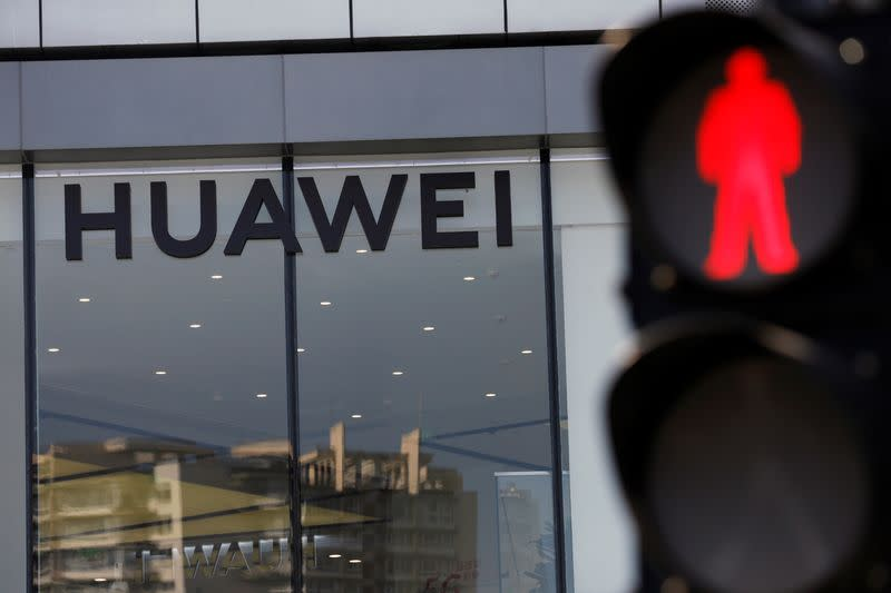 Huawei sign is seen on its store near a traffic light in Beijing