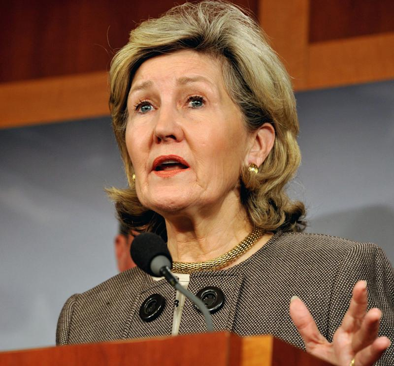 """<a href=""""http://www.senate.gov/artandhistory/history/common/briefing/women_senators.htm""""><strong>Served from:</strong></a> 1993-present Sen. Kay Bailey Hutchison (R-Texas) speaks to reporters on November 30, 2011 at Capitol Hill in Washington. (KAREN BLEIER/AFP/Getty Images)"""
