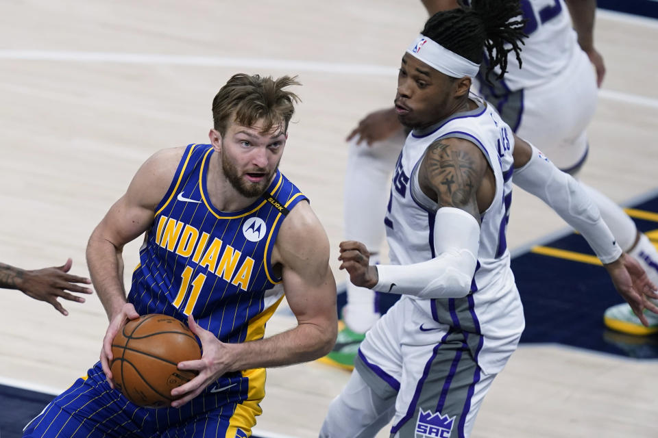 Indiana Pacers' Domantas Sabonis (11) goes to the basket against Sacramento Kings' Richaun Holmes (22) during the second half of an NBA basketball game Wednesday, May 5, 2021, in Indianapolis. (AP Photo/Darron Cummings)