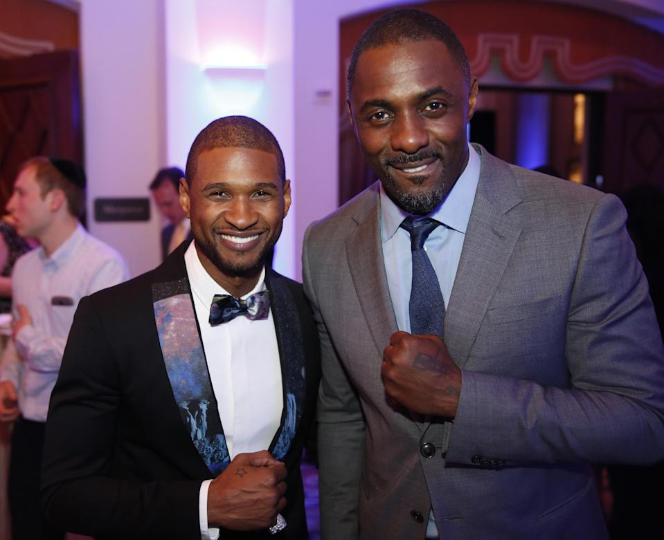 Usher, left, and Idris Elba are seen at the 3rd Annual Sean Penn & Friends HELP HAITI HOME Gala on Saturday, Jan. 11, 2014 at the Montage Hotel in Beverly Hills, Calif. (Photo by Colin Young-Wolff /Invision/AP)