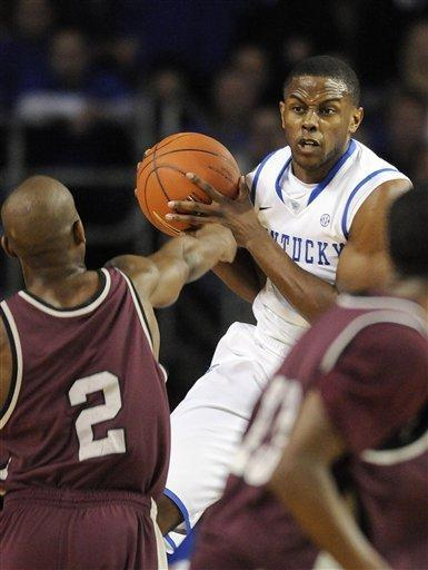 Kentucky's Darius Miller, right, grabs a rebound away from Arkansas-Little Rock's Terrence Jones during the first half of their NCAA college basketball game, Tuesday, Jan. 3, 2012, at Freedom Hall in Louisville, Ky. Kentucky defeated UALR 73-51. (AP Photo/Timothy D. Easley)