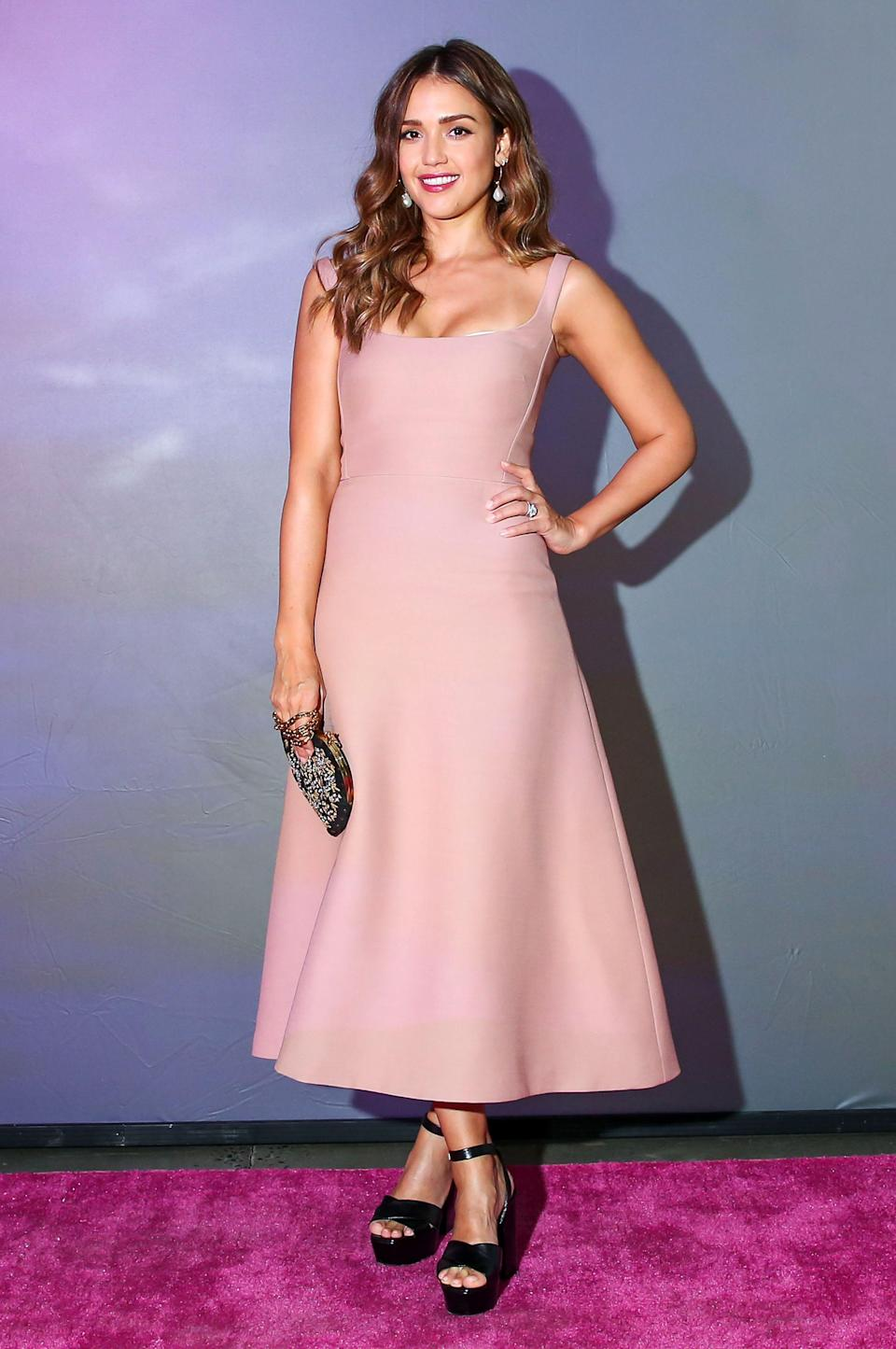 <p>Representing her beauty company 'Honest', Jessica slipped into a Dior midi dress with accessories and footwear by Saint Laurent for an awards event this month. <em>[Photo: Rex]</em> </p>