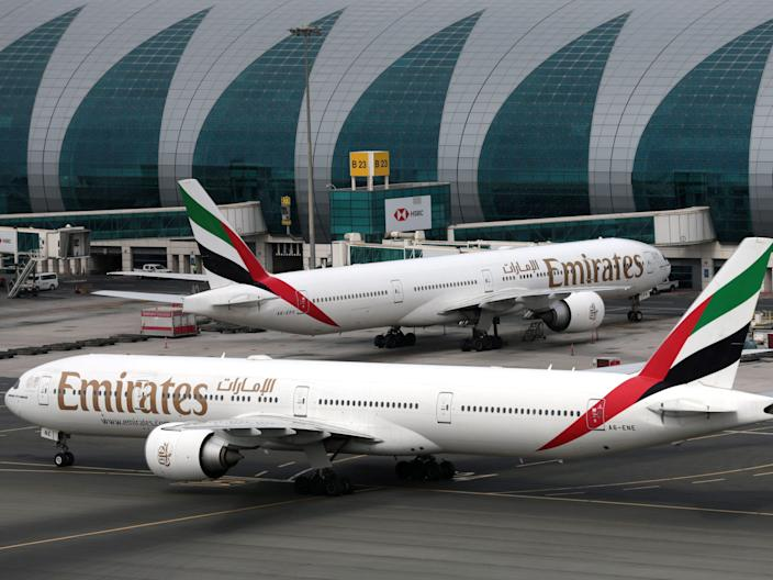 FILE PHOTO: Emirates Airline Boeing 777-300ER planes are seen at Dubai International Airport in Dubai, United Arab Emirates February 15, 2019. REUTERS/Christopher Pike