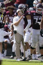 Texas A&M head coach Jimbo Fisher talks to quarterback Kellen Mond (10) during the first half of an NCAA college football game against Florida, Saturday, Oct. 10, 2020, in College Station, Texas. (AP Photo/Sam Craft)