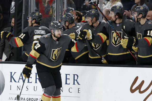Vegas Golden Knights defenseman Shea Theodore (27) celebrates after scoring against the Edmonton Oilers during the third period of an NHL hockey game Wednesday, Feb. 26, 2020, in Las Vegas. (AP Photo/John Locher)