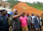"""Sierra Leone President Ernest Bai Koroma fought back tears on Tuesday as he visited the devastated hilltop community of Regent, saying the scale of the challenge ahead was """"overwhelming us"""""""