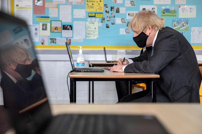 The prime minister visits a school to take part in an online lesson during lockdown (POOL/AFP via Getty Images)
