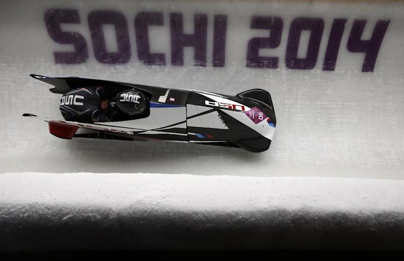 The team from the United States USA-3, piloted by Nick Cunningham and brakeman Dallas Robinson, take a curve during the men's two-man bobsled competition at the 2014 Winter Olympics, Monday, Feb. 17, 2014, in Krasnaya Polyana, Russia. (AP Photo/Natacha Pisarenko)