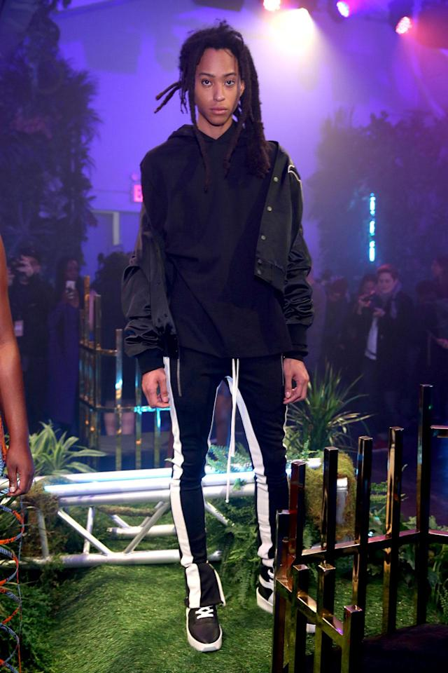 <p>Model wears a letterman jacket with 'Black Panther' on the back designed by Feat of God at the Black Panther Welcome to Wakanda NYFW fashion presentation. (Photo: Courtesy of Marvel Studios Black Panther/Getty) </p>