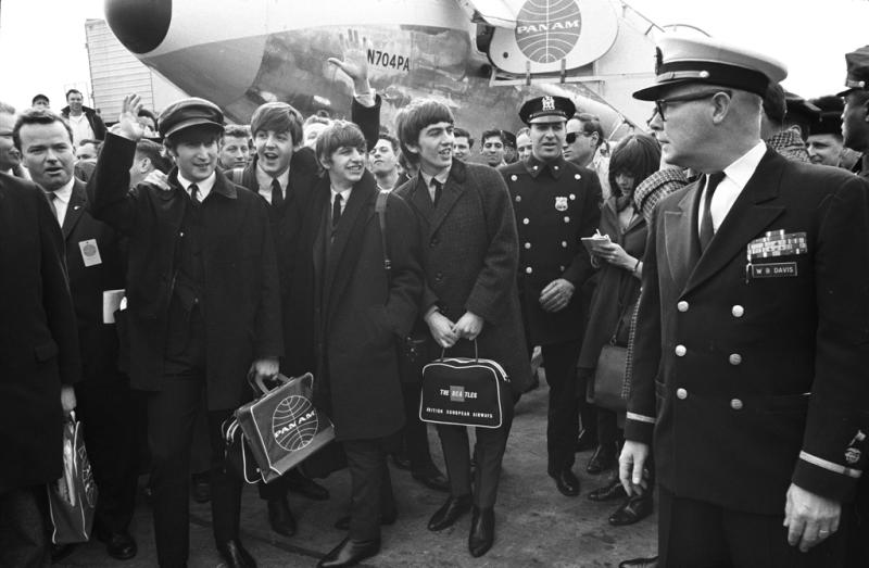 This Feb. 7, 1964 photo taken by photojournalist Bill Eppridge and released courtesy of Monroe Gallery shows The Beatles arriving at JFK airport in New York. Eppridge, whose legendary career included capturing images of a mortally wounded Robert Kennedy died Thursday, Oct. 3, 2013 in Danbury, Conn., after a brief illness. He was 75. (AP Photo/courtesy of Monroe Gallery, Bill Eppridge)