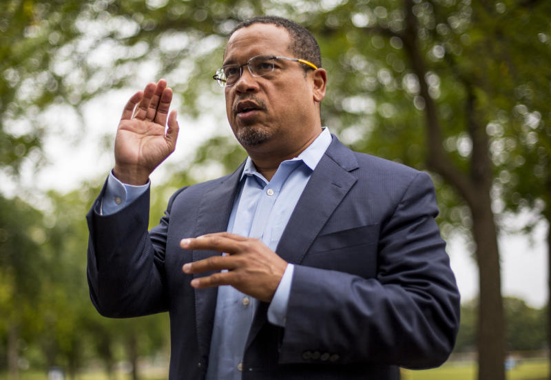 Rep. Keith Ellison addresses his campaign volunteers and supporters before sending them off on a door knocking campaign, Friday, Aug. 17, 2017 in Minneapolis. Minnesota Rep. Keith Ellison said Friday he won't abandon his campaign for attorney general amid allegations that he once physically abused an ex-girlfriend and said if she claims to have a video of the incident she should produce it. (Alex Kormann/Star Tribune via AP)