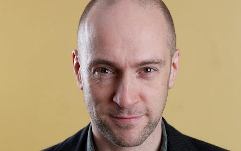 'Look into my eyes...' Mentalist and illusionist Derren Brown subtly demonstrates his domnant side with a slightly lowered chin - Credit: Clara Molden for The Telegraph