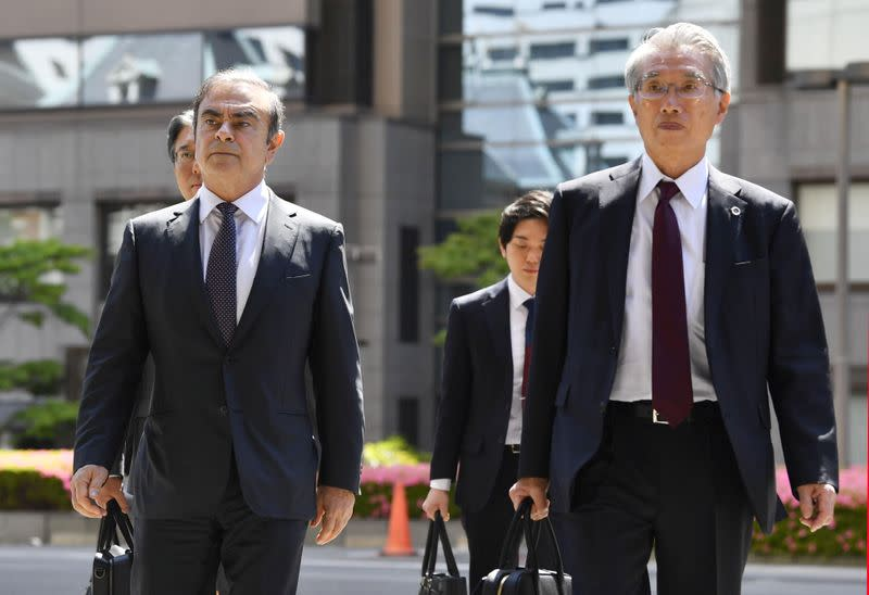 Former Nissan Motor Co. Chairman Carlos Ghosn and his lawyer Junichiro Hironaka arrive at the Tokyo District Court for the first pretrial procedures in his financial misconduct case, in Tokyo