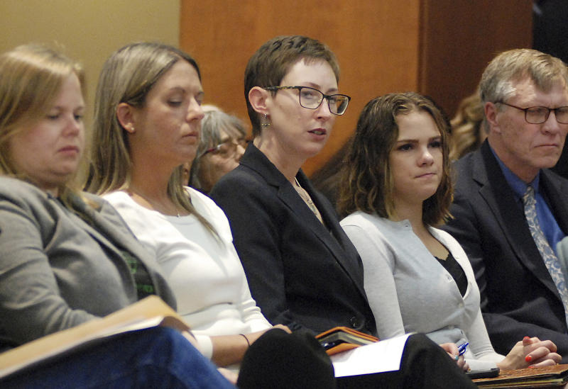 FILE - This Monday, April 15, 2019, file photo shows New Mexico Energy, Minerals and Natural Resources Secretary Sarah Cottrell Propst, center, attending a congressional field hearing about the affects of methane pollution on sacred Native American historical sites in Santa Fe, N.M. (AP Photo/Morgan Lee, File)