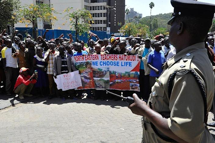 A policeman looks on as Kenyan teachers demonstrate in Nairobi on February 3, 2015, refusing to go back to their workplaces and asking to be reassigned to other regions, citing insecurity in northern states of Mandera, Wajir and Garissa (AFP Photo/Simon Maina)