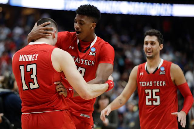 Texas Tech's Matt Mooney, Jarrett Culver and Davide Moretti, from left, celebrate the team's 75-69 win over Gonzaga during the West Regional final in the NCAA men's college basketball tournament Saturday, March 30, 2019, in Anaheim, Calif. (AP Photo/Marcio Jose Sanchez)