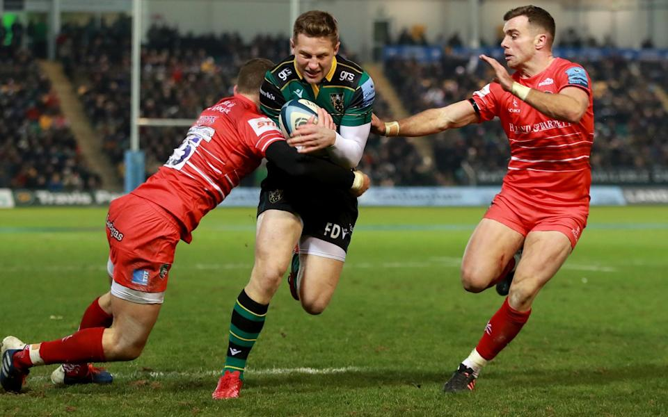 Fraser Dingwall of Northampton Saints scores a second half try despite being held by George Ford (R) and George Worth - Getty Images