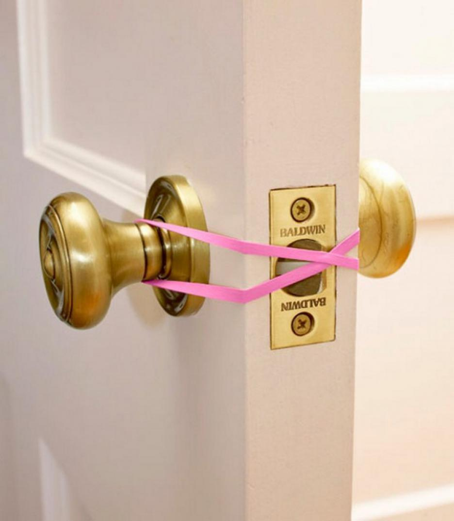 Hands full with groceries? Keep doors open by crossing a rubber band across the latch. Now you can go back and forth without fumbling with the door knob!