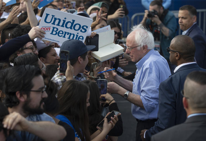 Sen. Bernie Sanders, I-Vt., signs autographs to Latino supporters at a campaign event at Valley High School in Santa Ana, Calif., Friday, Feb. 21, 2020. (Damian Dovarganes/AP)