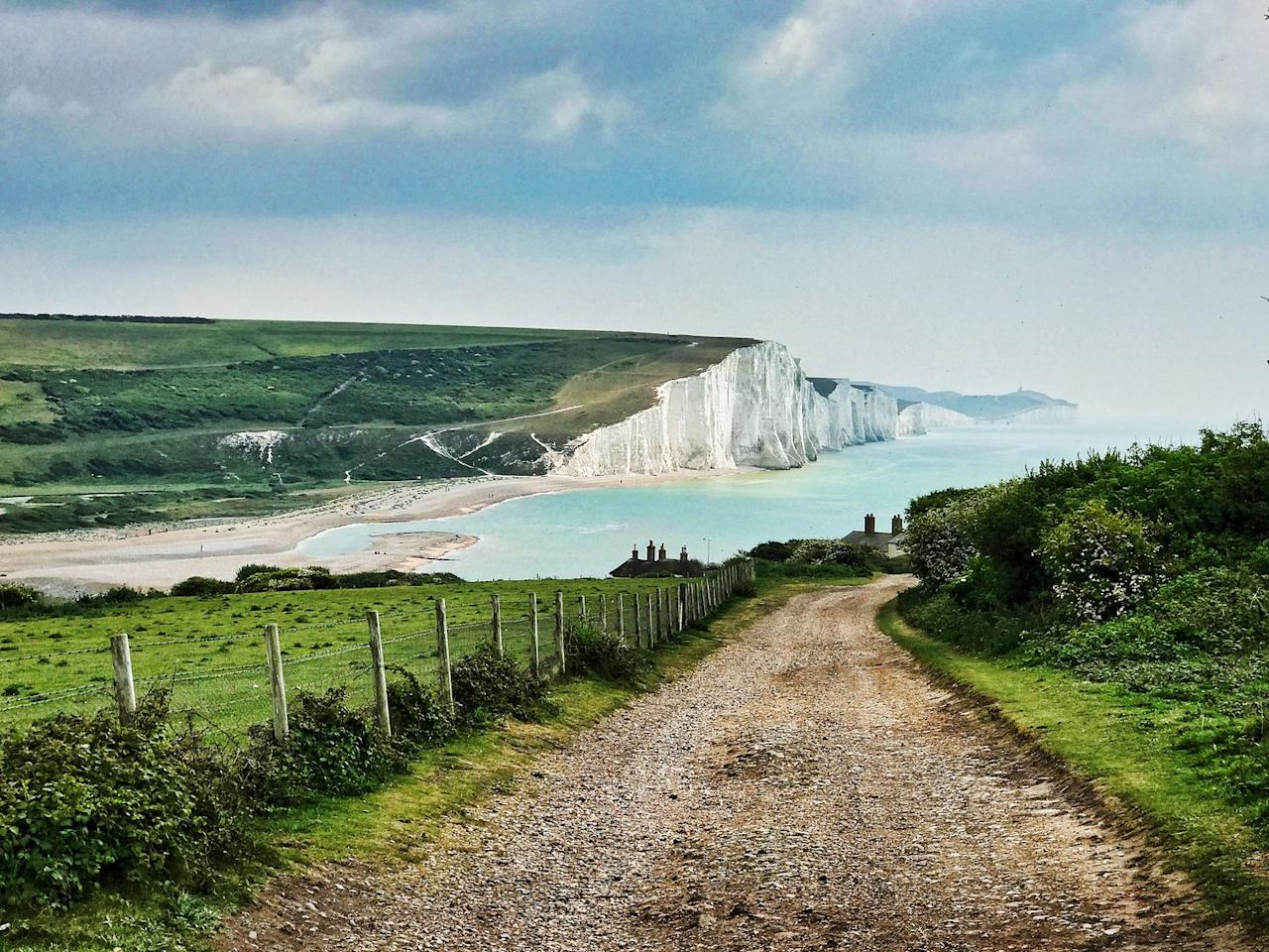 """<p>A range of chalk hills that extend for a whopping 260 square miles across the south-eastern coastal counties of England from Hampshire to East Sussex, the South Downs are a must-see when considering a day trip out of the Big Smoke. </p><p>There are several ways to explore the Downs but we suggest doing so by foot on the Seven Sisters <a href=""""https://www.countryfile.com/go-outdoors/walks/walk-seven-sisters-east-sussex/"""" target=""""_blank"""">route</a> which covers approximately 3.7 miles (2 hours) and overlooks the sea. </p><p><strong>Distance from London</strong>: 61.4 miles</p><p><strong>How to get there</strong>: London Waterloo to Petersfield via <a href=""""https://www.thetrainline.com/book/results?journeySearchType=single&origin=bc3771e2481f260d7c07c163139d187d&destination=efe712fb159e3d3bc15e08a48e92dcc2&outwardDate=2020-07-16T14%3A15%3A00&outwardDateType=departAfter&passengers%5B%5D=1990-07-16&selectExactTime=true&selectedOutward=H3qur204aA0%3D%3Aoxzcuqkc0U0%3D"""" target=""""_blank"""">train</a> (1hr 3mins)</p>"""