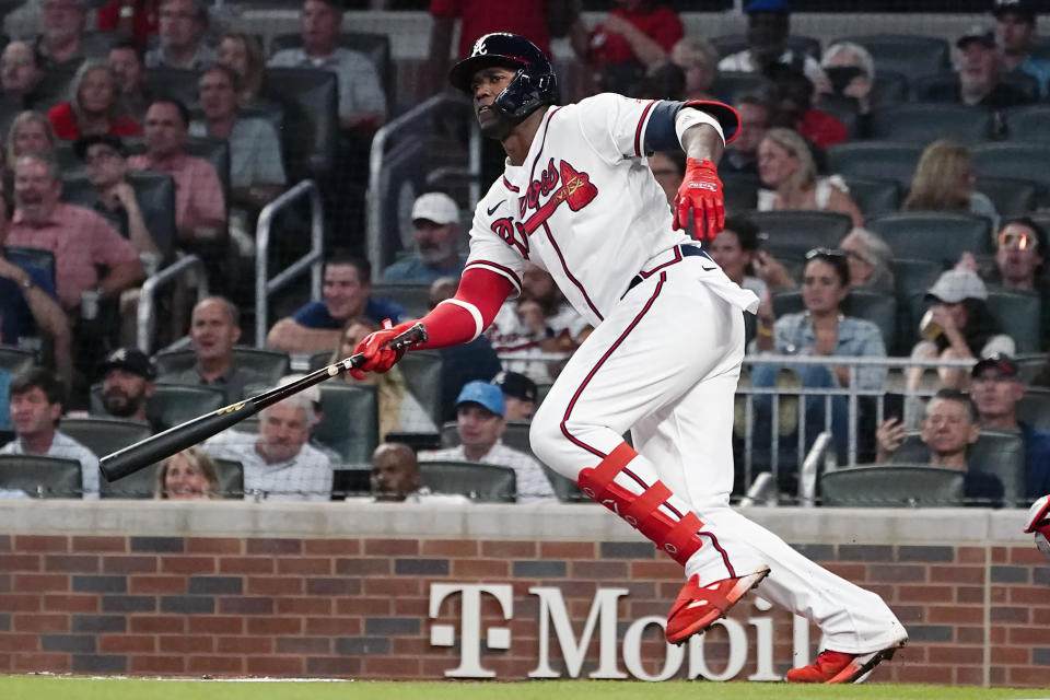 Atlanta Braves' Jorge Soler (12) drives in two runs with a base hit in the third inning of a baseball game against the Philadelphia Phillies Tuesday, Sept. 28, 2021, in Atlanta. (AP Photo/John Bazemore)